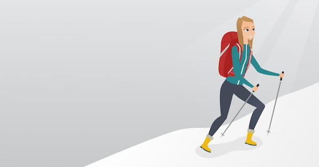 雪に覆われた尾根を登る白人の登山家。