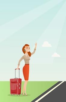 ヒッチハイクのスーツケースを持つ若い白人女性。