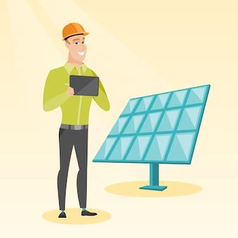 太陽光発電所の白人の労働者。