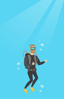 Молодой кавказский аквалангист, давая пальца вверх