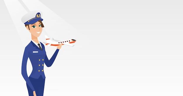 Веселый пилот авиакомпании с макетом самолета.