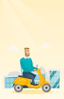 Молодой человек кавказской, езда на скутере.
