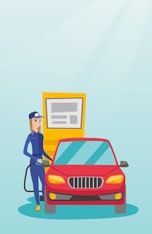 労働者は車に燃料を充填します。