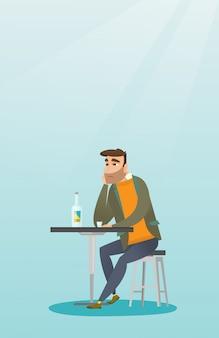 男はバーでカクテルを飲みます。