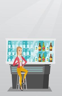バーのカウンターに座っている白人女性。