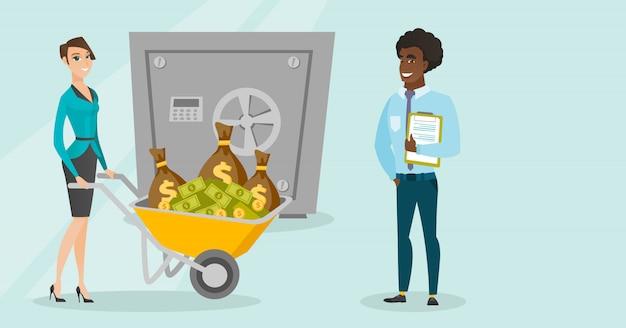 ビジネスの女性が安全な銀行にお金を預けます。