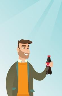 若い男がソーダを飲む