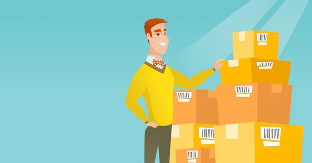 ビジネスの男性が倉庫内のボックスをチェックします。