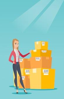 ビジネスの女性が倉庫内のボックスをチェックします。