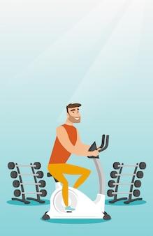 若い男が乗って静止した自転車。