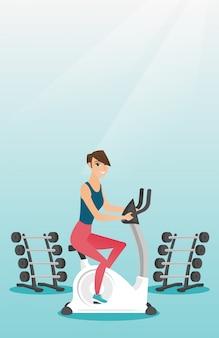 静止した自転車に乗る若い女性。