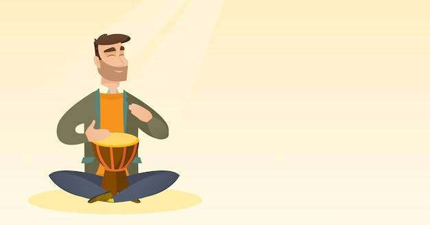 民族のドラムを弾く男