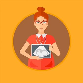超音波画像と妊娠中の女性。
