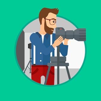 カメラマンが三脚にカメラを操作します。