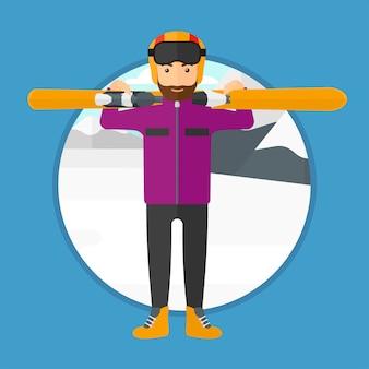 Мужчина держит лыжи.
