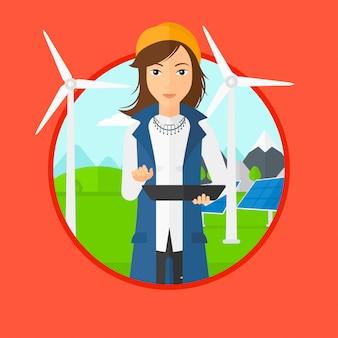 Работница солнечной электростанции и ветропарка.