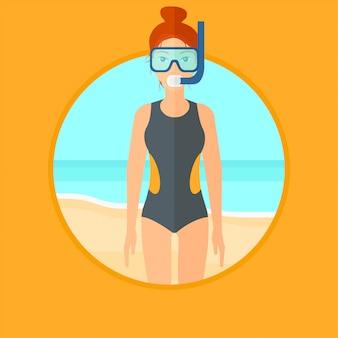 Женский аквалангист на пляже.