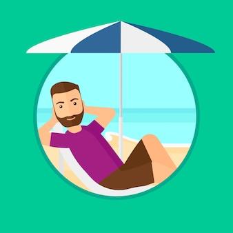 男はビーチチェアでリラックス。