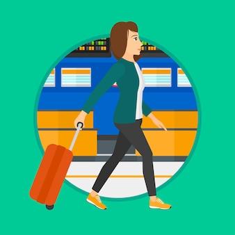 空港でスーツケースを持って歩く女性。