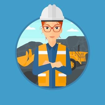 大きなショベルを持つ鉱山労働者