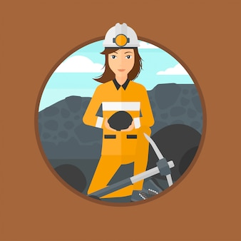 鉱山労働者が手で石炭を保持しています。