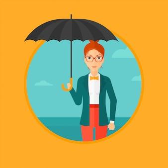 傘を持つ女性実業家。