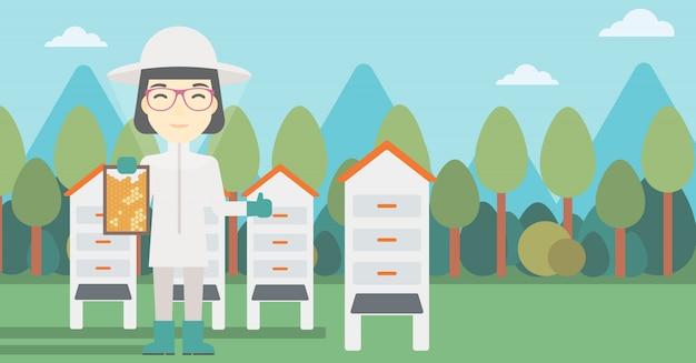 養蜂場での女性の蜂キーパー
