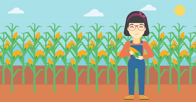 Женщина-фермер держит кукурузу