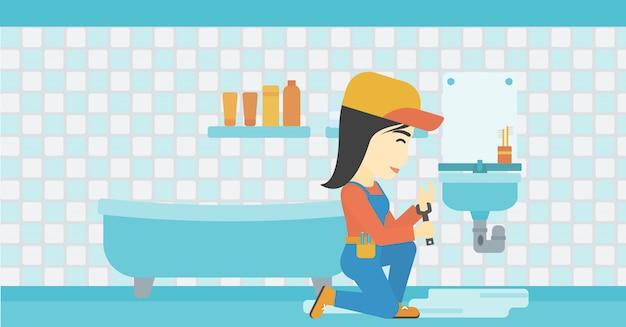 Женщина ремонтирует раковину.