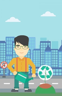 リサイクルサインを持つ木に水をまく人。