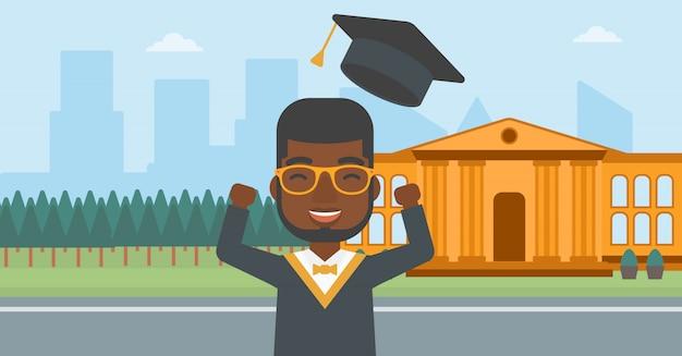 大学院生は彼の帽子を投げます。