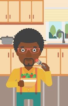 Человек ест салат.