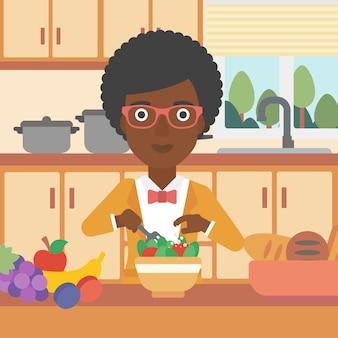野菜料理のサラダを調理する女性。