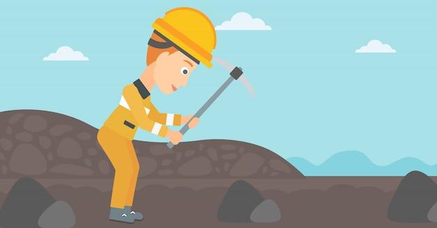 鉱山労働者はピックを扱う。