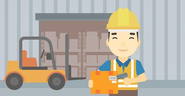 倉庫作業員がボックスのバーコードをスキャンします。