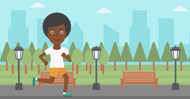陽気な女性がジョギングします。