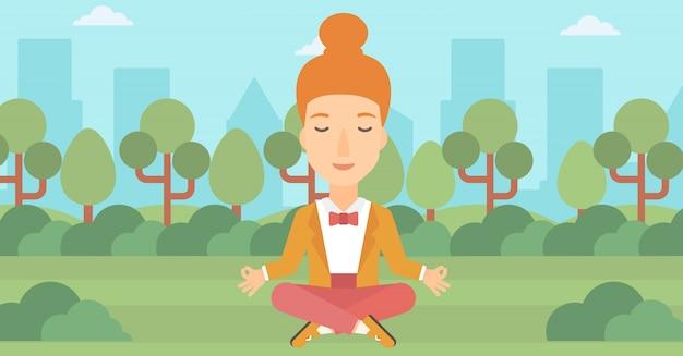 ビジネスの女性が蓮のポーズで瞑想します。