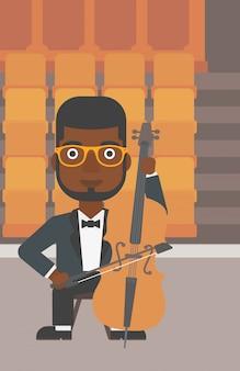チェロを弾く男。