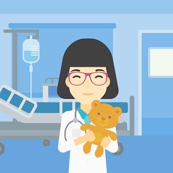 小児科医医師テディベアを保持しています。