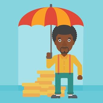 お金を保護する傘を持ったビジネスマン。