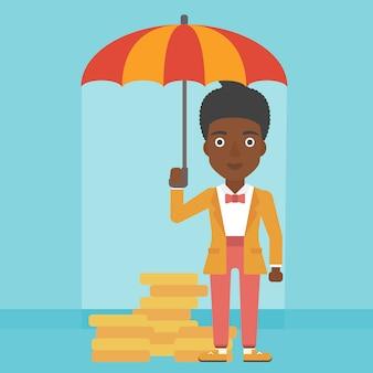 お金を保護する傘を持つ女性実業家。