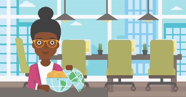 お金でいっぱいの地球儀を持つ女性実業家。