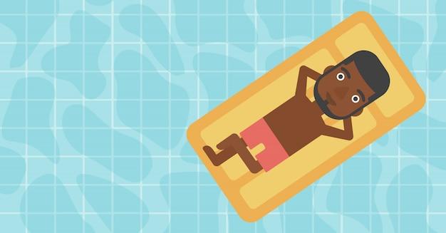 スイミングプールでリラックスした男