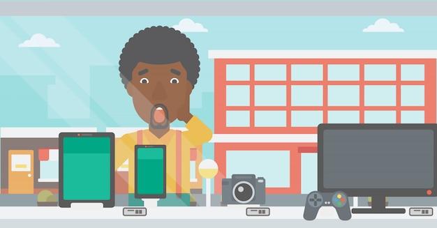 Человек, глядя на цифровой планшет и смартфон.