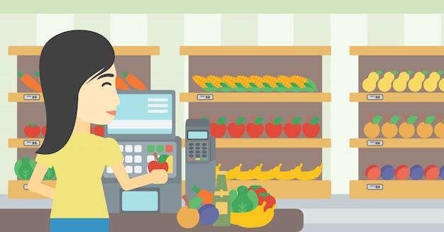 レジ係はスーパーでレジに立っています。