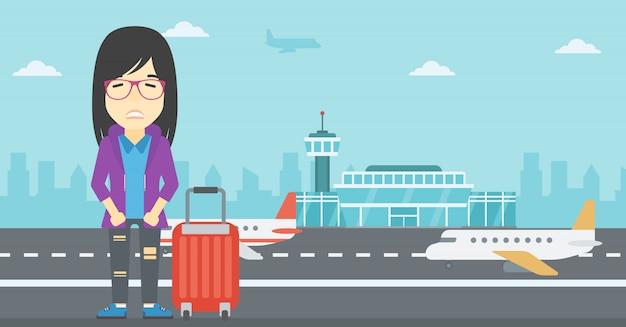Женщина страдает от страха полета.