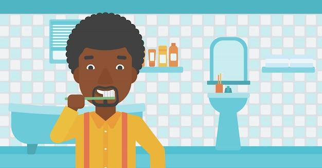 男は歯を磨きます。