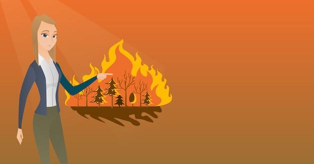山火事の隣に立っている女性。