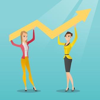 Два деловых женщин, занимающих график роста.