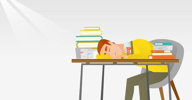 本を机で寝ている学生。